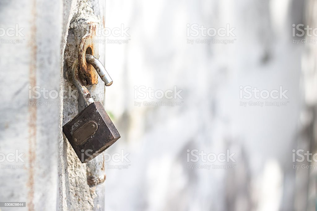Rusty old metal padlock stock photo