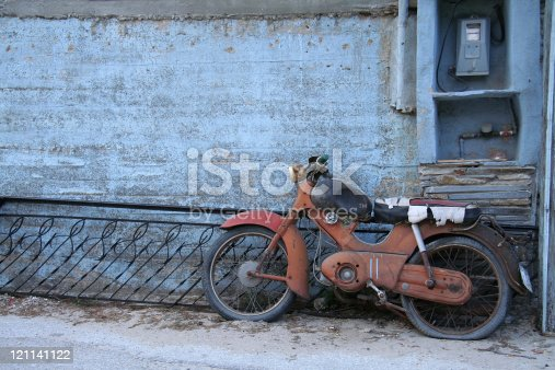 Worn-out motorbike in the village Maries on the island Thassos in Greece. Copyspace