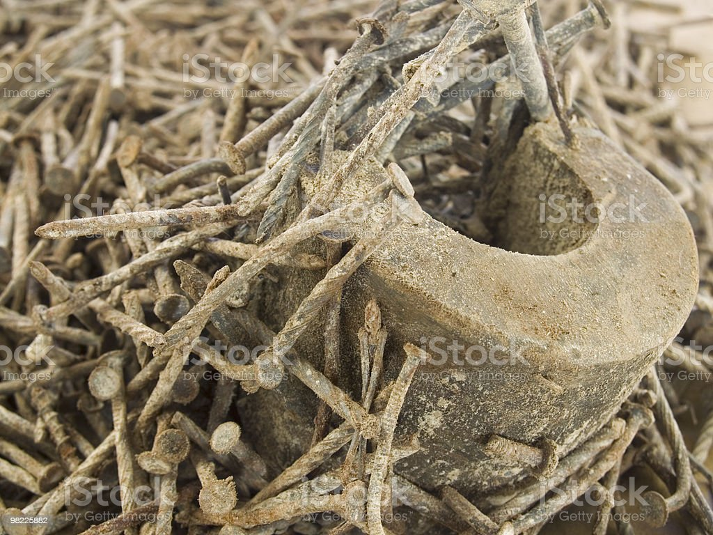 Rusty old nails and a magnet royalty-free stock photo