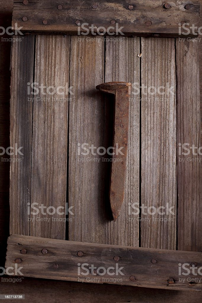 Rusty Old Railroad Spike and Wood stock photo