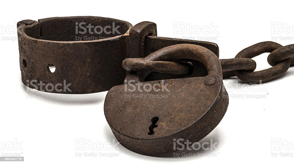 Rusty old shackles with padlock stock photo
