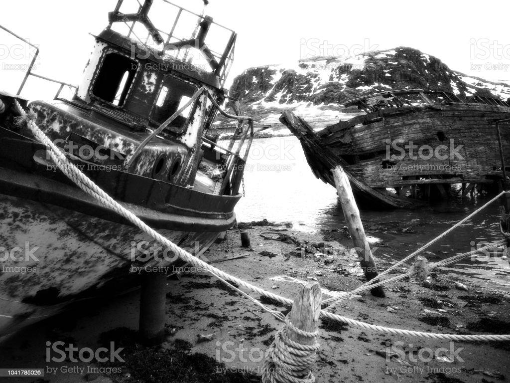 Rusty old shipwreck ruins in Teriberka stock photo