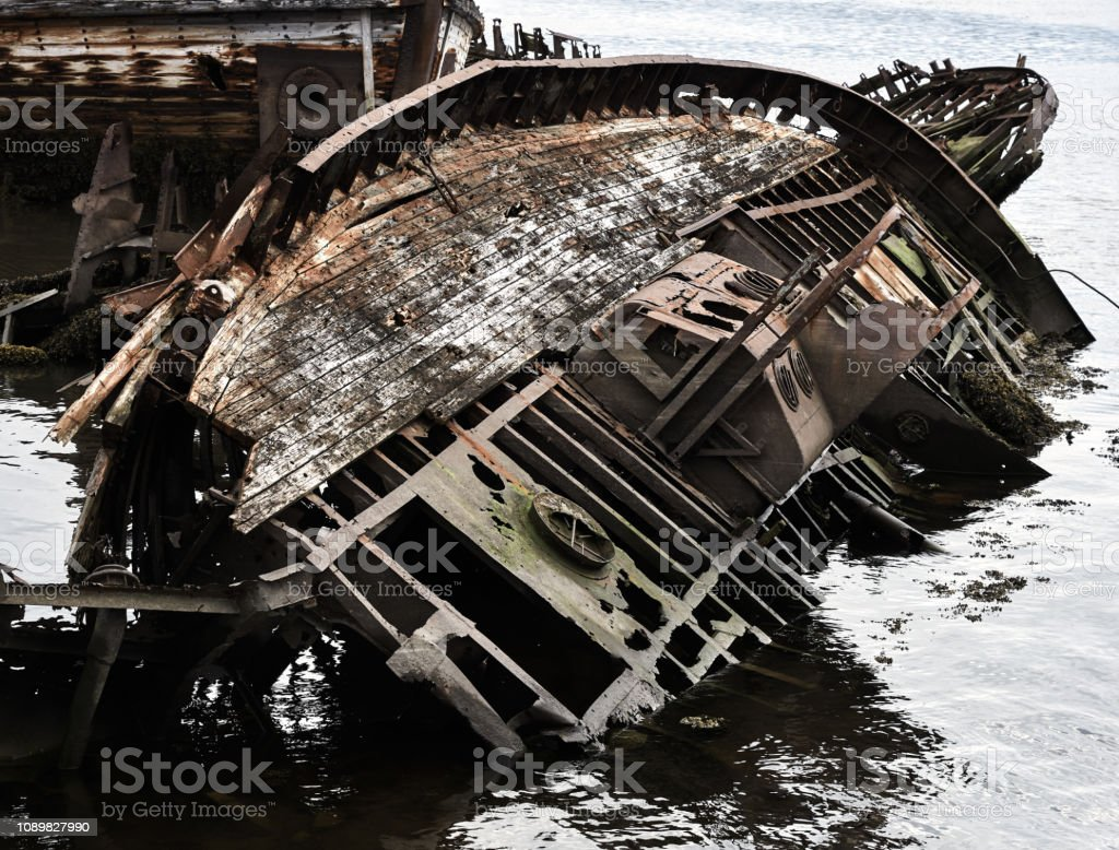Rusty old shipwreck ruins stock photo