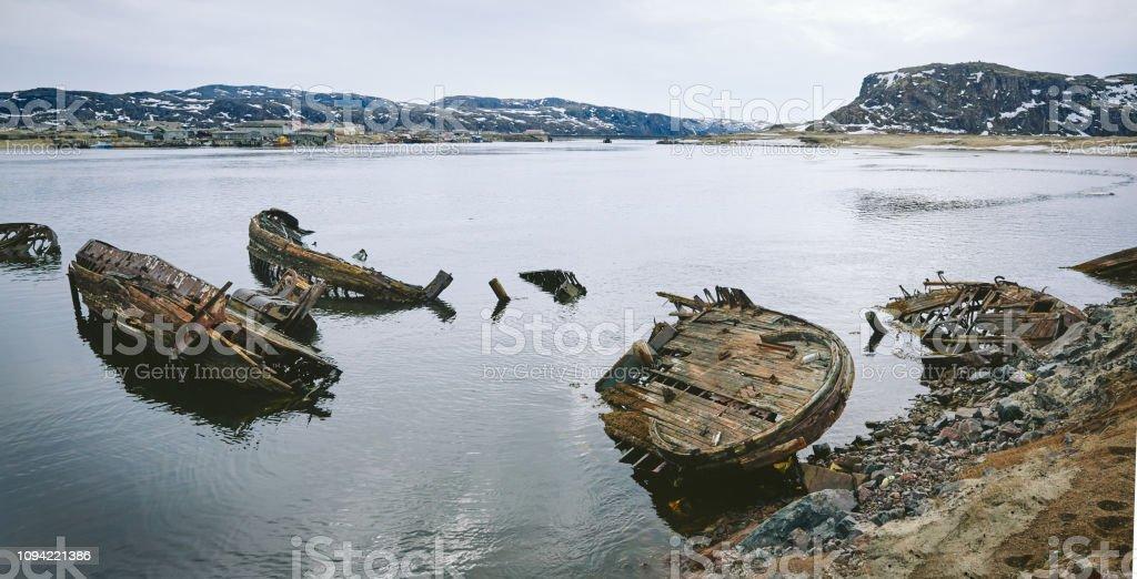 Rusty old shipwreck ruins, Teriberka stock photo
