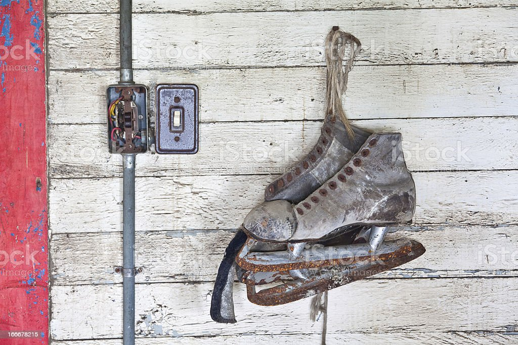 Rusty Old Skates on a Wall stock photo