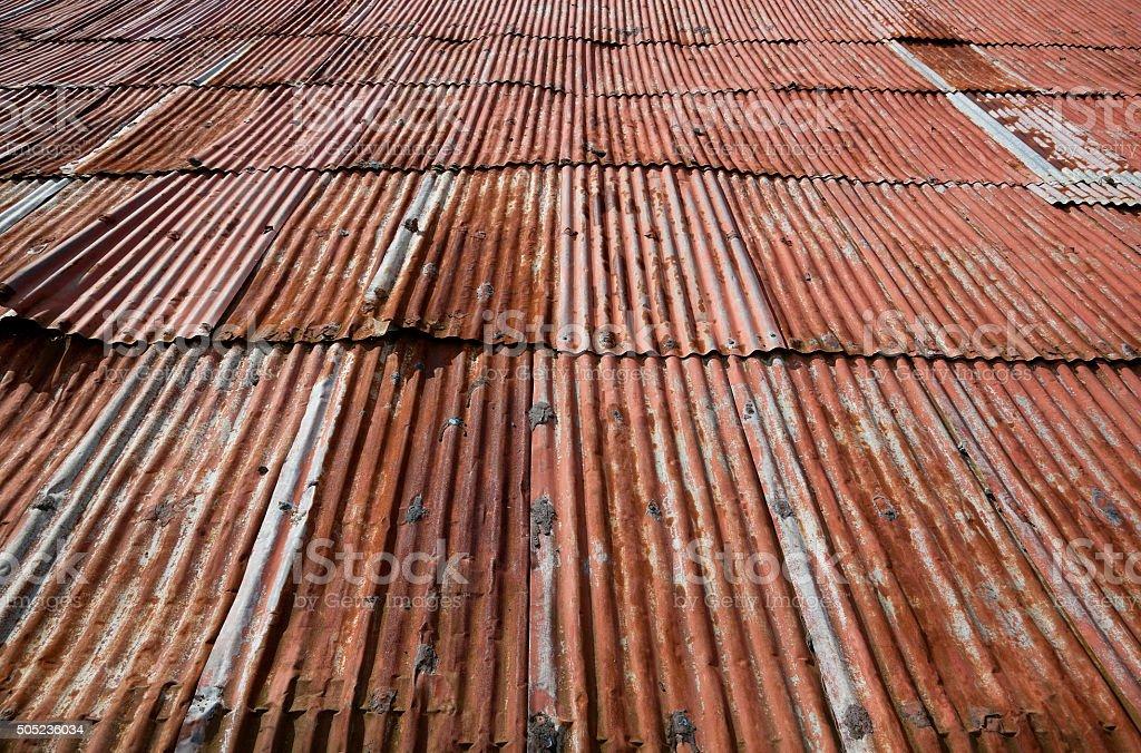 Rusty Old Tin Roof on Barn in Nicaragua stock photo
