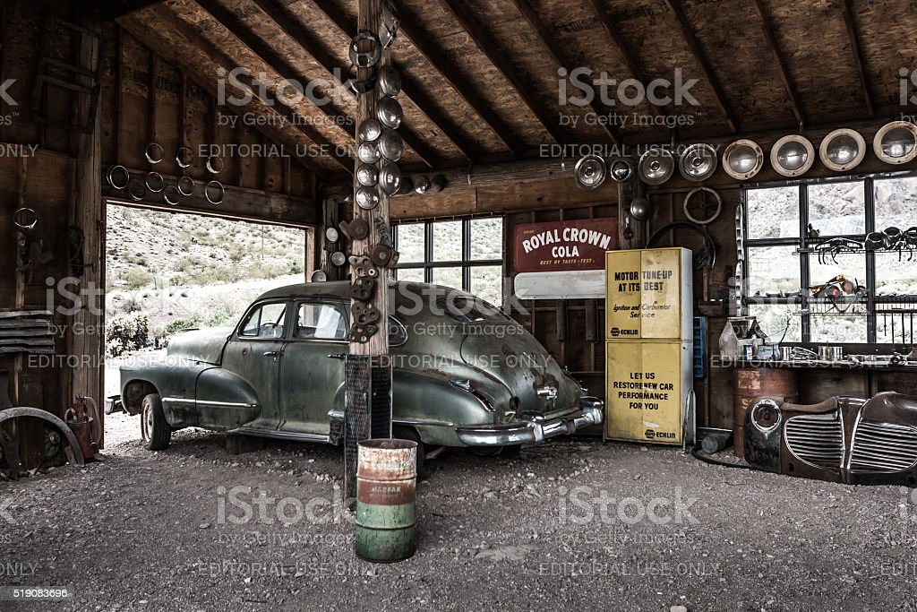 Rusty old vintage car in abandoned mechanic garage stock photo