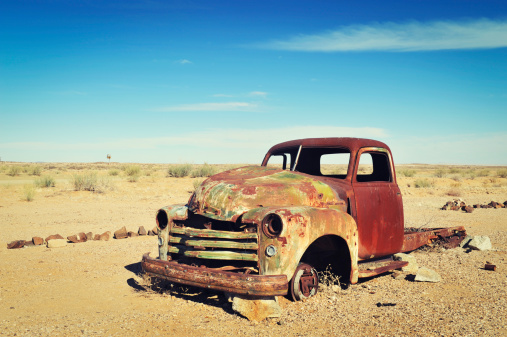Rusty abandoned old wreck in the Namibian Desert.