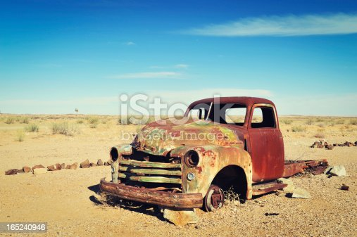 istock Rusty old wreck abandoned in the Namibia Desert 165240946