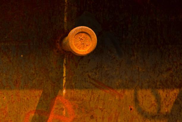Rusty Orange Steel Rod and Plate in Sun Light