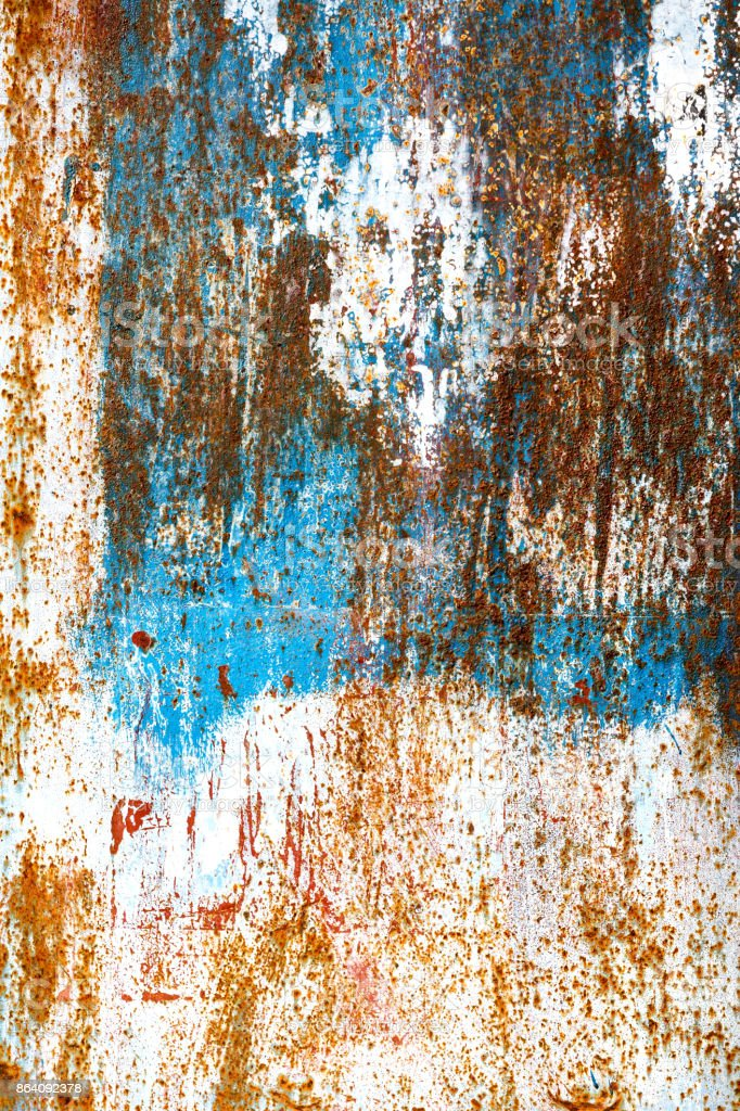 Rusty painted blue and white metal. Rough scratched structure. Background with copy space. royalty-free stock photo