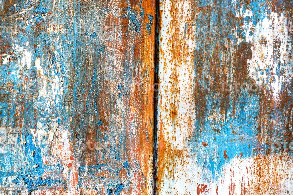 Rusty painted blue and white metal. Rough scratched structure. Background with copy space. stock photo