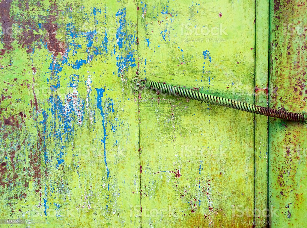 Rusty painted green metal texture with cracked paint. stock photo