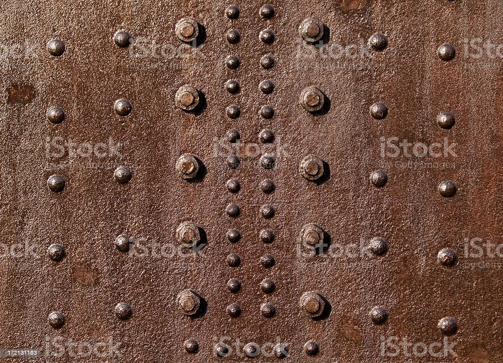 rusty red rivets royalty-free stock photo