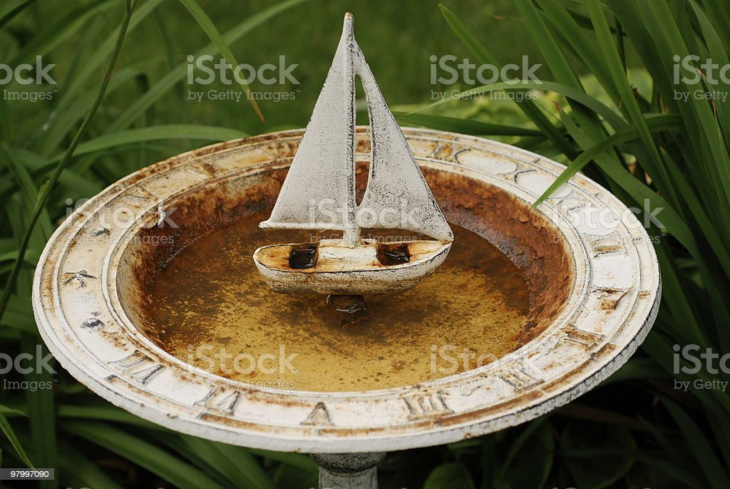 rusty sailboat sundial birdbath royalty-free stock photo