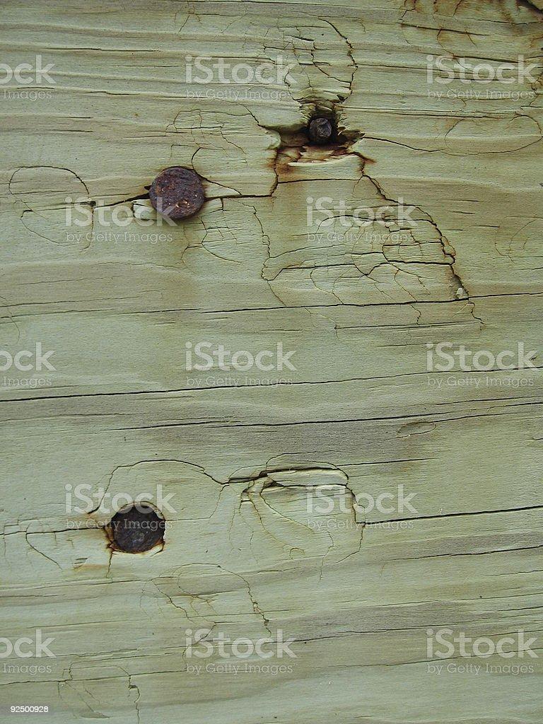 Rusty Screws in Greenish Wood royalty-free stock photo