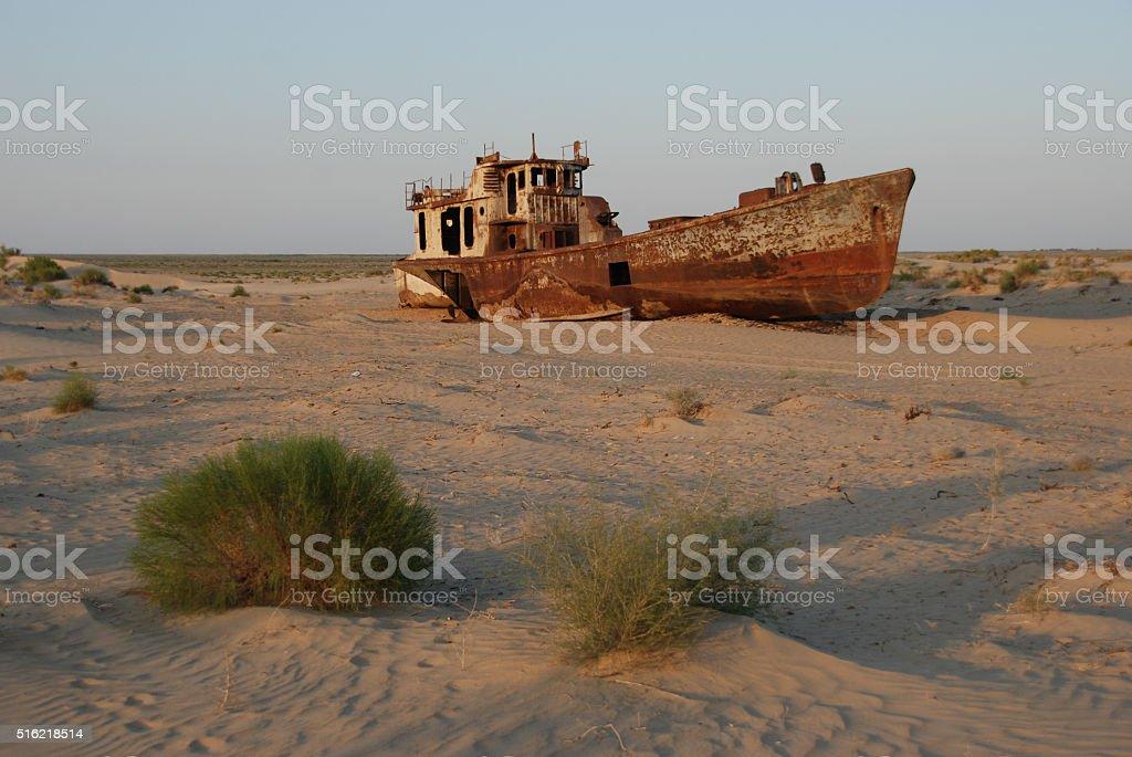Rusty ship of Aral Sea fishing fleet stock photo