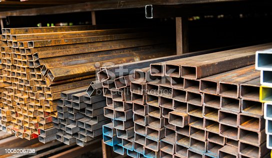 istock Rusty square steel tubes on the shelf 1005206738
