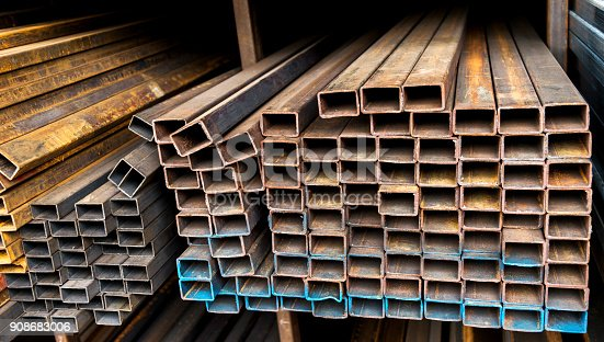 istock Rusty square steel tubes on the shelf 908683006