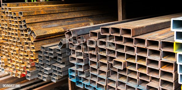 istock Rusty square steel tubes on the shelf 908683186