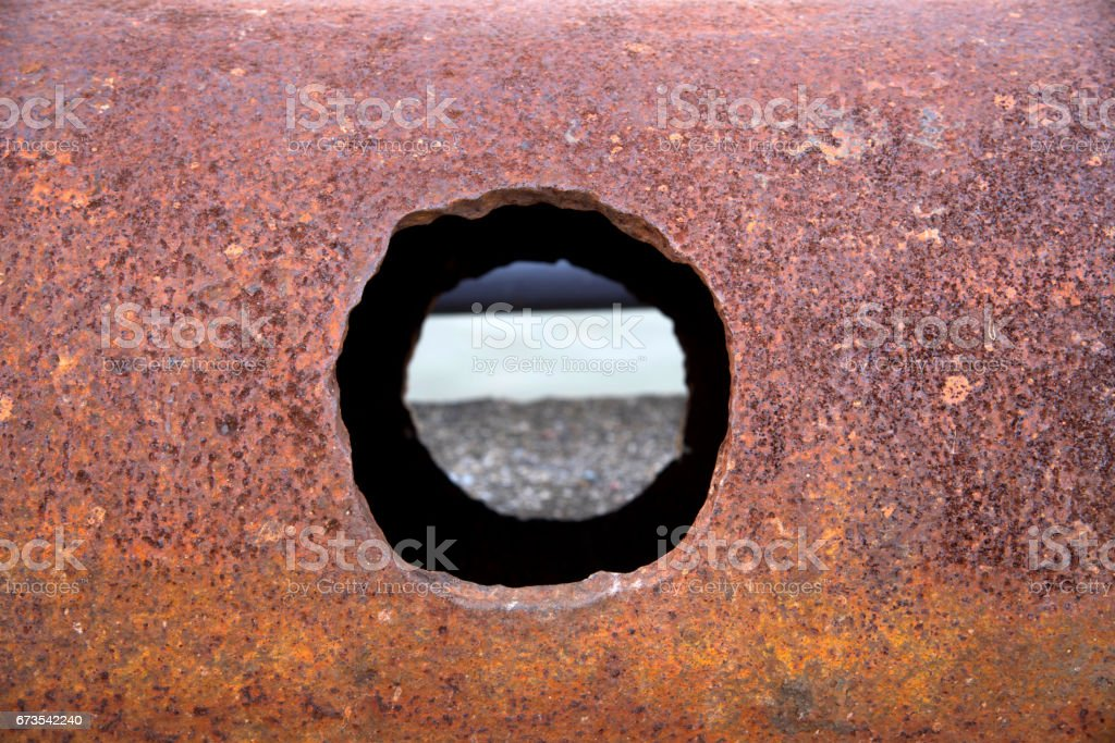 Rusty steel and hole. royalty-free stock photo