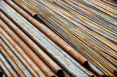 Rusty steel pipes in a row