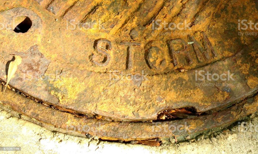 Rusty Storm Drain Manhole stock photo