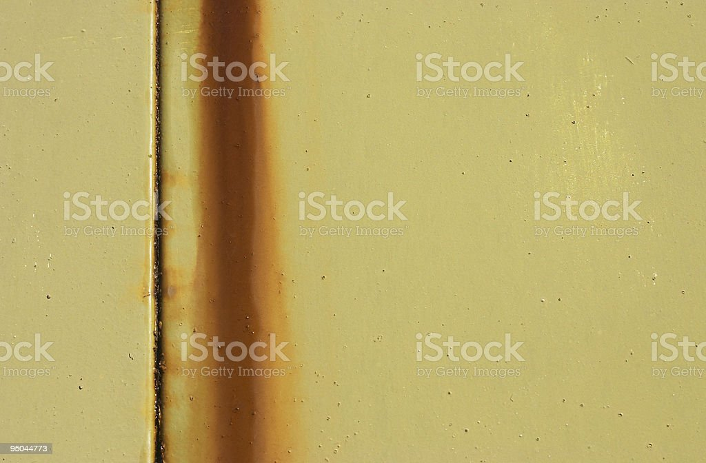 Rusty streaks on green / yellow metal garage door stock photo