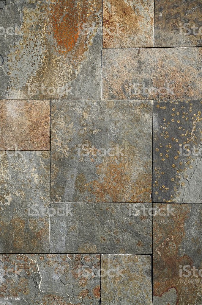 Rusty textured stone tiled wall royalty-free stock photo