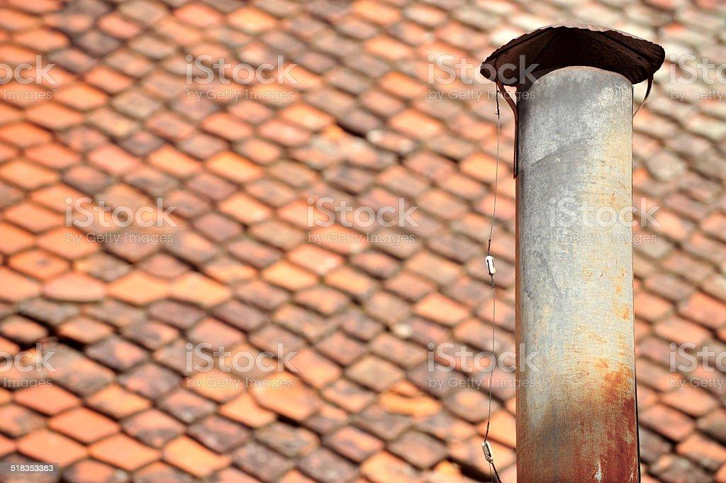 Rusty tin chimney stock photo