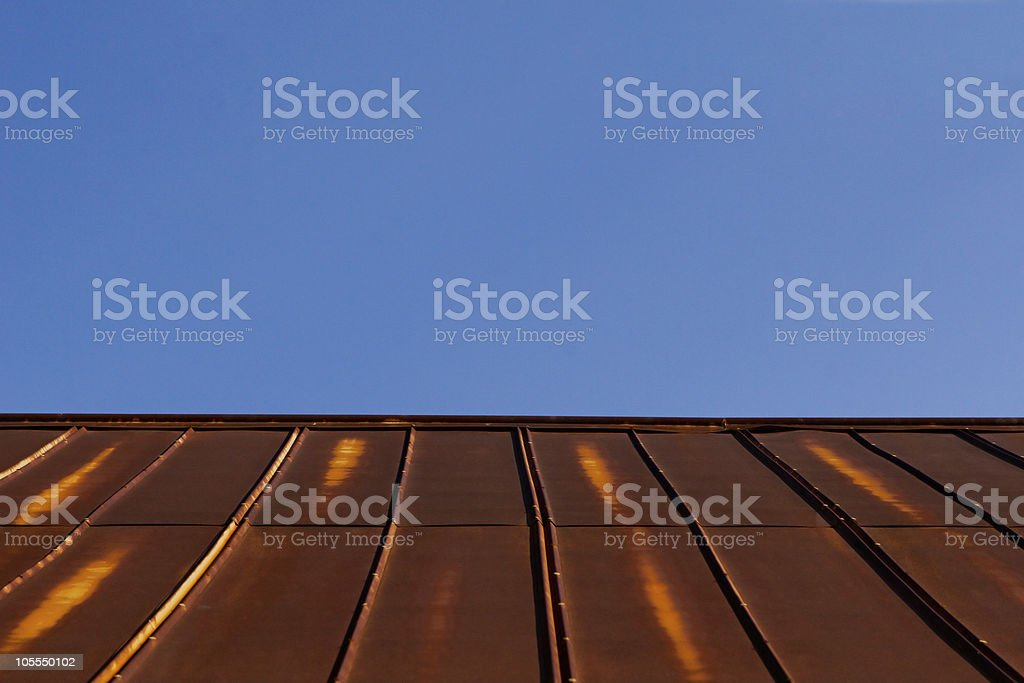 Rusty Tin Metal Roof & Clear Blue Sky royalty-free stock photo