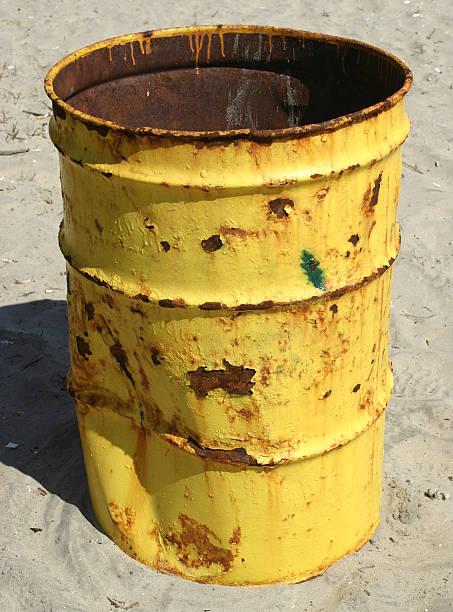 rusty trash can on the beach stock photo