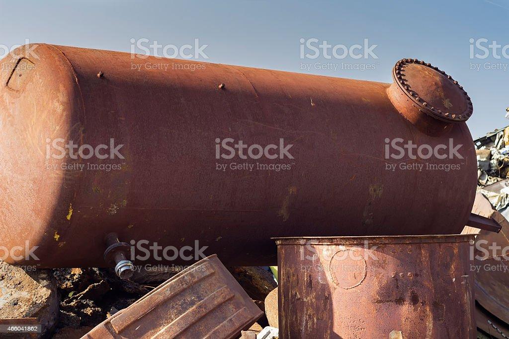 Rusty underground storage tank on junkyard stock photo