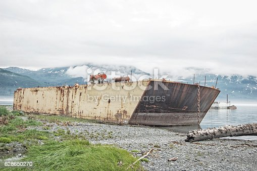 This abandoned vessel is located in the bay near Valdez, Alaska.  Abandoned and left to rust on the shoreline, this vessel shows its age and years of hard labor.