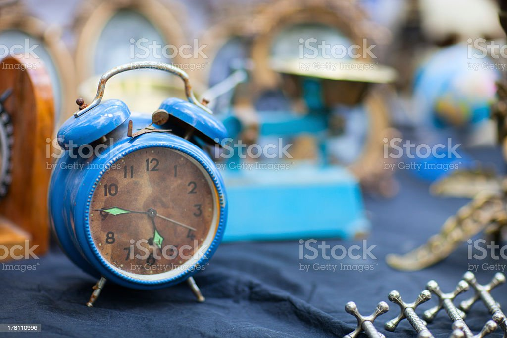 Rusty vintage alarm clock with blurred background stock photo