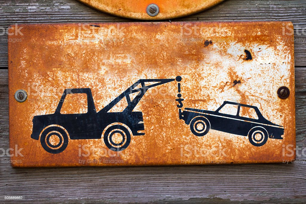Rusty Vintage Tow Away/No Parking Sign stock photo