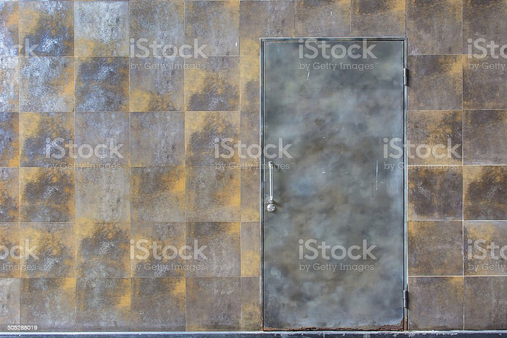 rusty wall background with metal door royalty-free stock photo