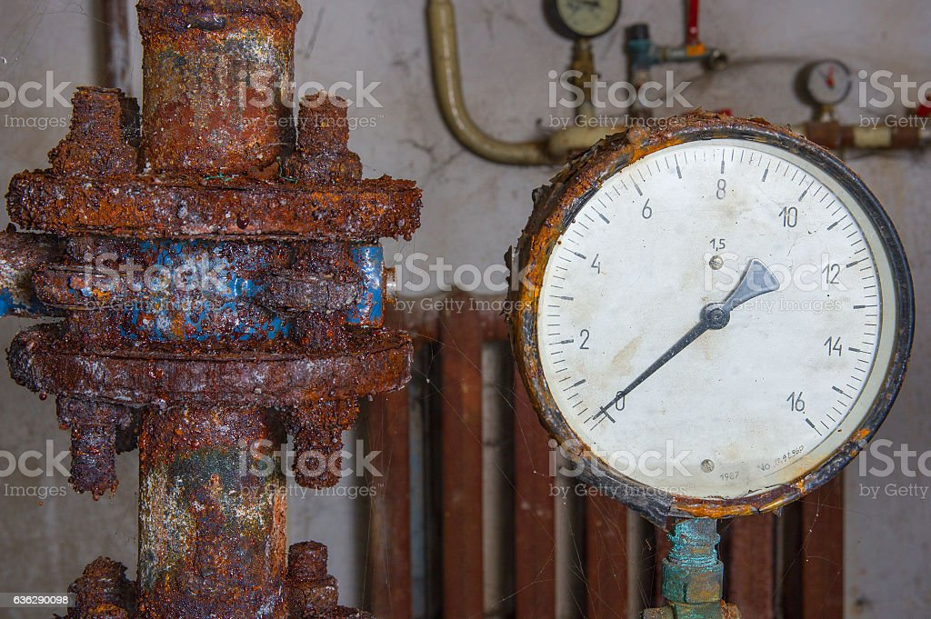 Rusty water pipe, valve and manometer stock photo