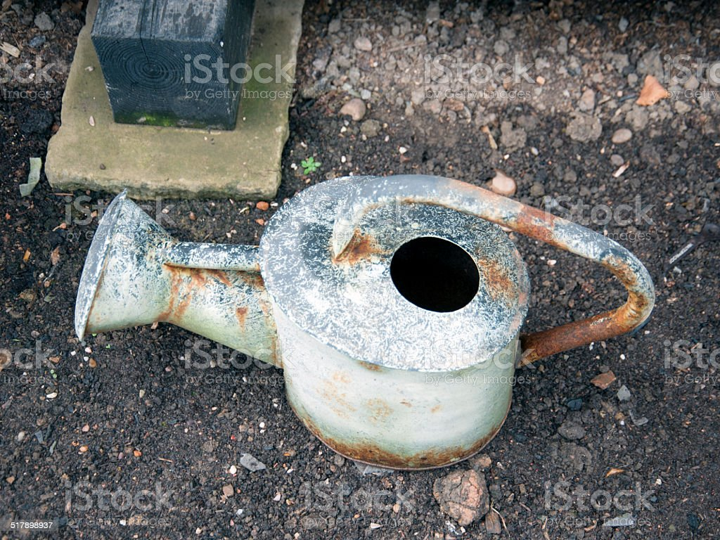 Rusty Watering Can stock photo
