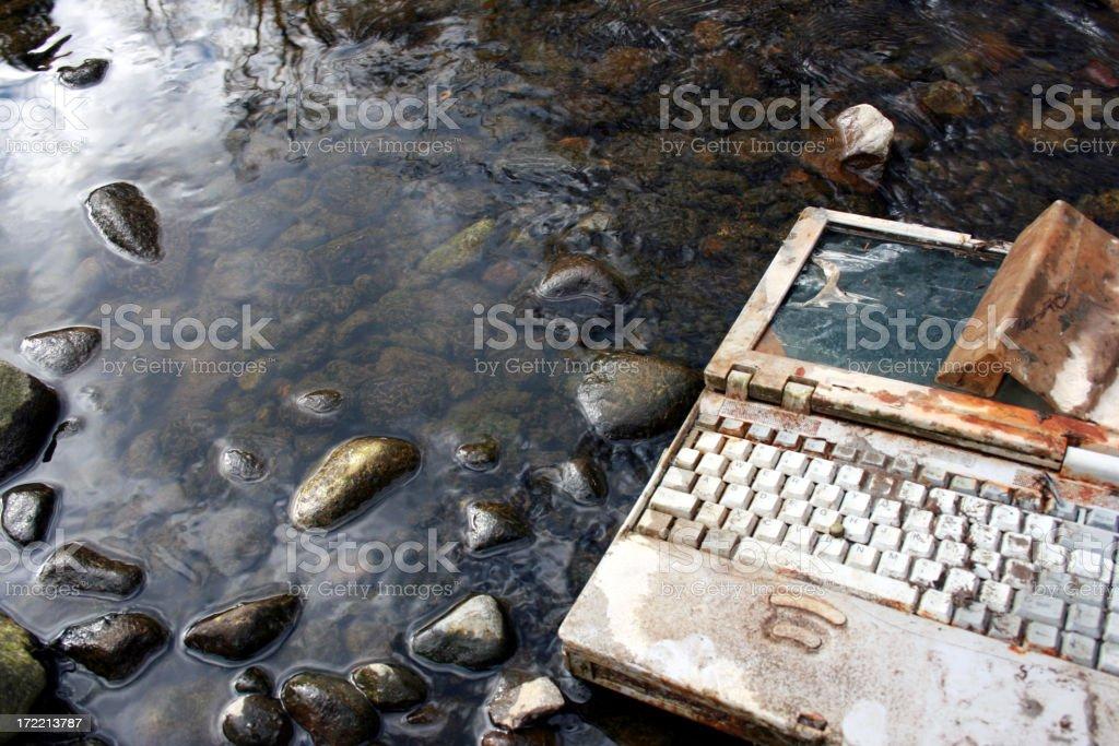 Rusty Wet Laptop Lying in Stream royalty-free stock photo