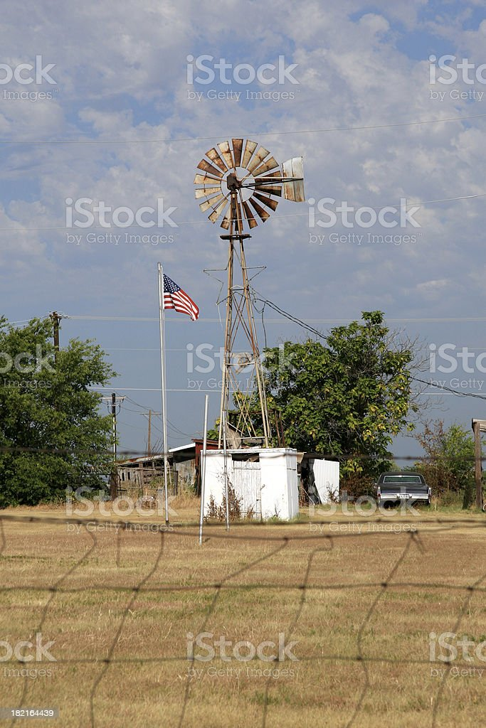 Rusty windmill on old pasture land stock photo