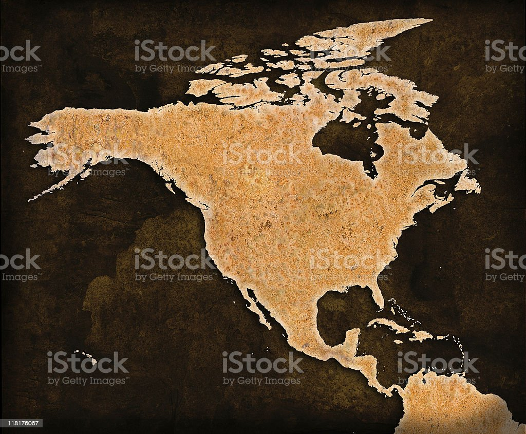 Rusty World Map on grungey brown background North America royalty-free stock photo