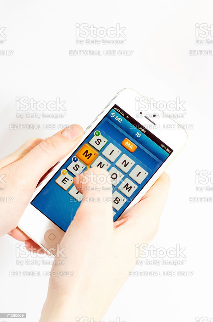 Ruzzle app on an iPhone 5 royalty-free stock photo