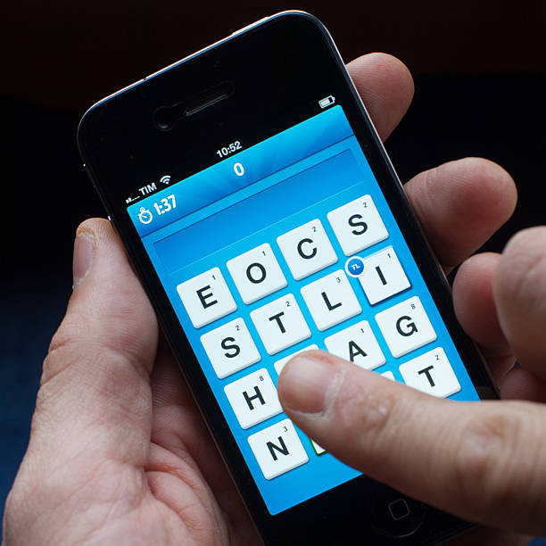 ruzzle on iphone - word game stock pictures, royalty-free photos & images