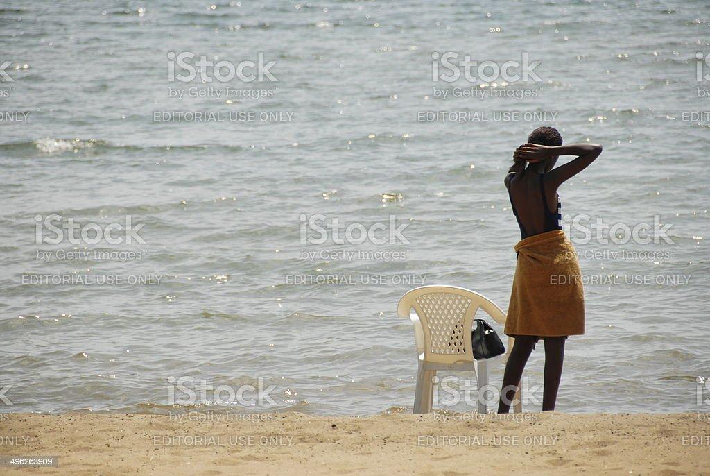 Rwandan woman at the Lake Kivu shore in Gisenyi, Rwanda. stock photo