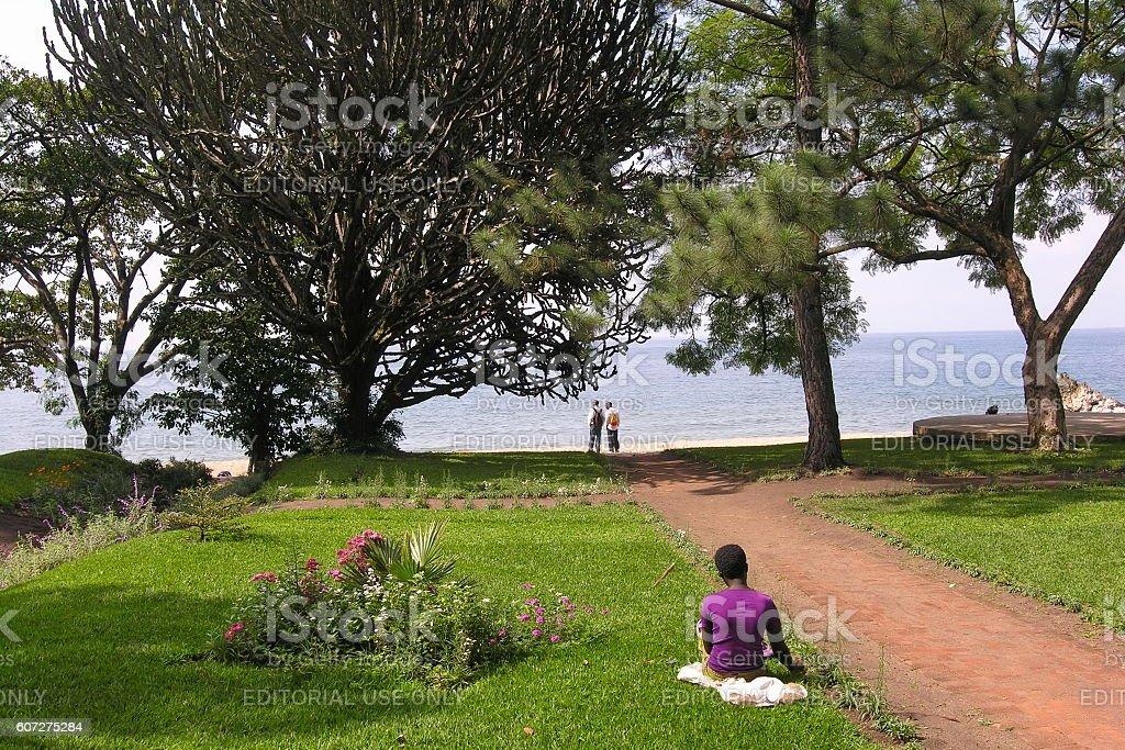 Rwandan woman takes rest near Lake Kivu shore, Gisenyi, Rwanda. stock photo