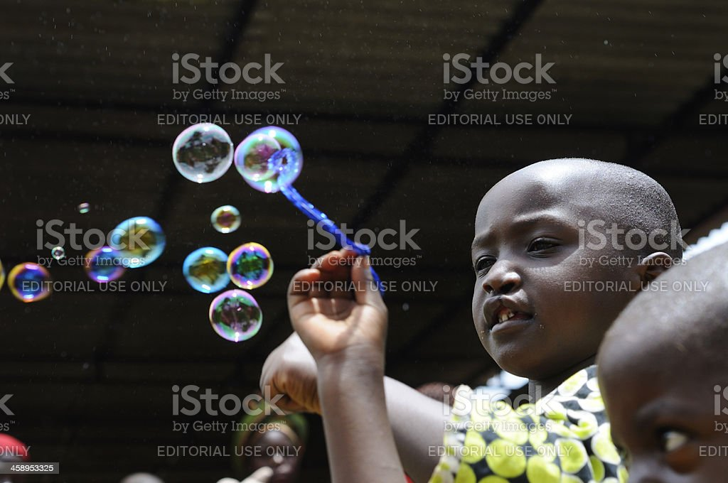Rwandese children playing with soap bubbles stock photo