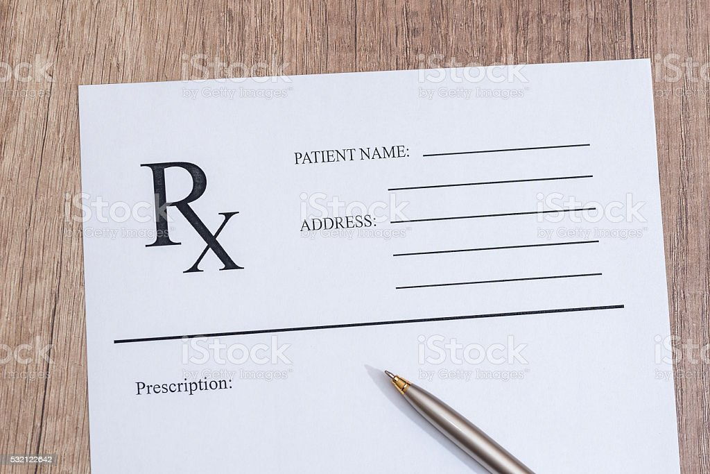 rx blank with pen on desk stock photo