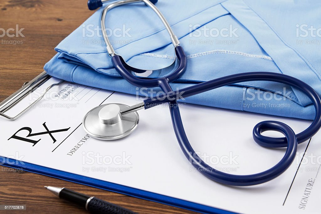 Rx Form with Heart Shape Stethescope on Doctor's Desk stock photo