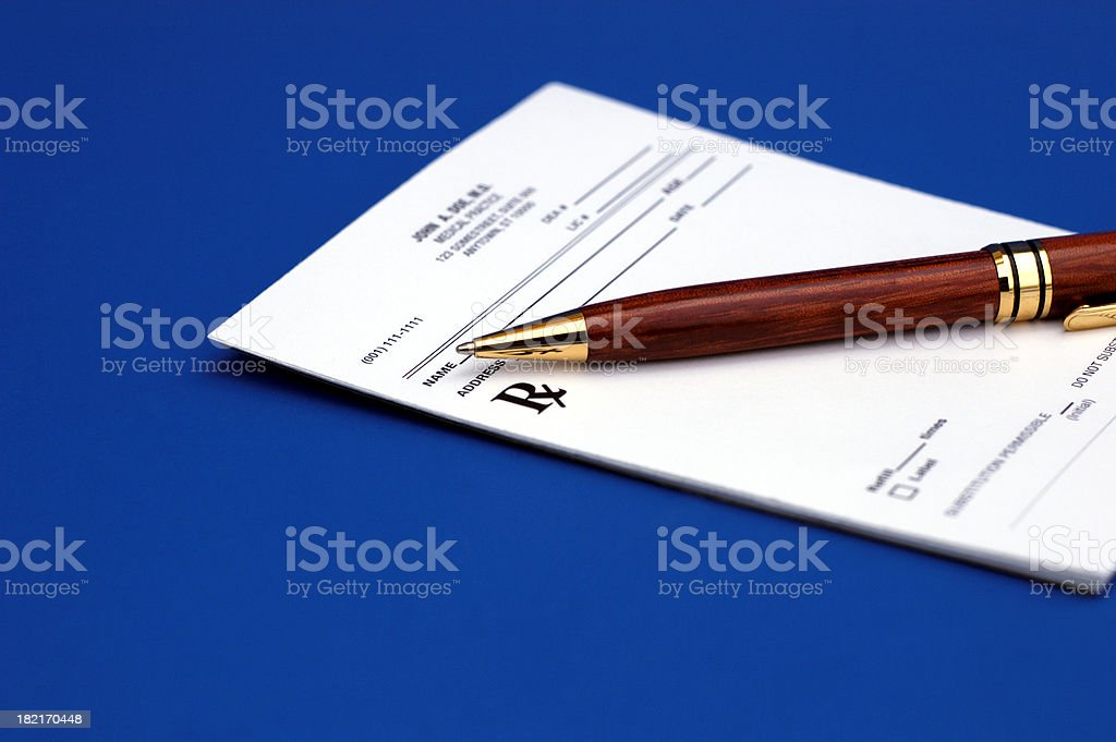 Rx on blue with pen royalty-free stock photo